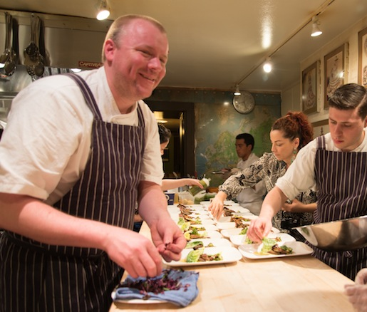 Chef Justin Smillie happily plates his quail dish